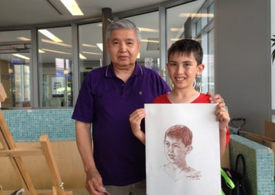 Frank Tonido with a young boy