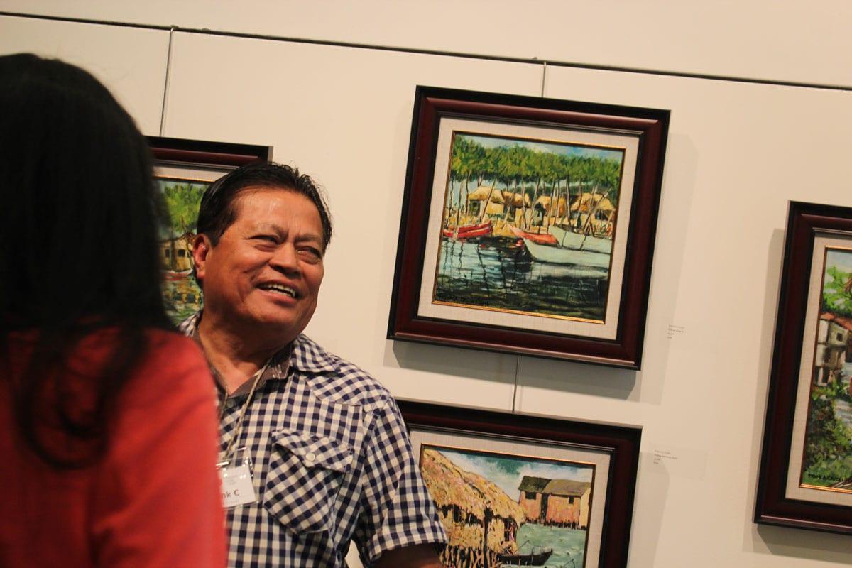 Frank Cruzet with his paintings - Iniibig ko ang Pilipinas